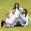 Happy family smiling of a mum and dad with their kids — Stock Photo #10637808
