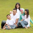 Stock Photo: Happy family smiling of a mum and dad with their kids