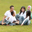 Happy big family in the park — Stock Photo #10637814