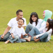 Happy big family in the park — Stock Photo