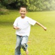 Happy young boy running — Stock Photo