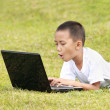 Shocked kid on laptop — Stock Photo