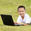 Kid with laptop — Stock Photo