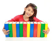 Portrait of schoolgirl smiling with her books on his arms agains — Stock Photo