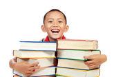 Barn leende med boken på bröstet — Stockfoto
