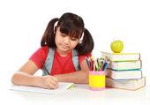 Schoolgirl writing something — Stock Photo