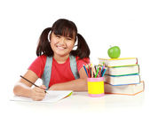 Portrait of happy young girl studying — Stock Photo