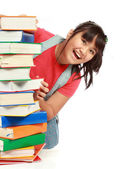 Pile of book with lovely kid behind it smiling — Stock Photo