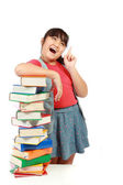 Portrait of young girl with her books and look up to copy space — Stock Photo