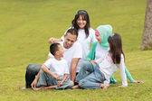 Happy family portrait outdoors — Stock Photo