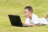 Shocked kid on laptop — Stock Photo