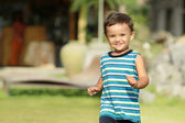Young kid running and smiling — Stock Photo