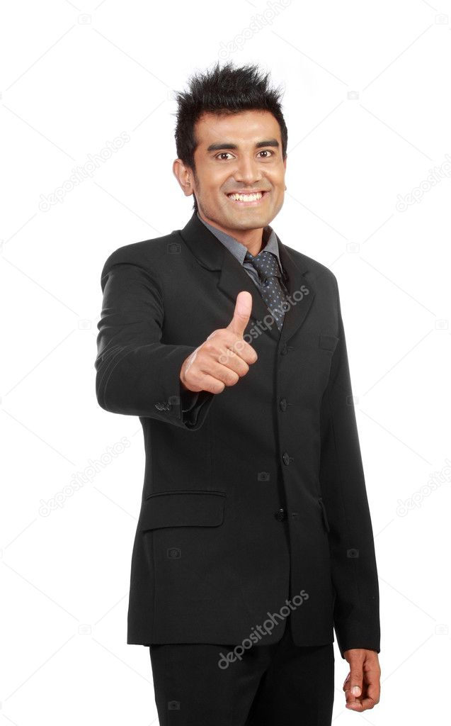 A handsome businessman with thumbs up on an isolated white background — Stock Photo #10636850