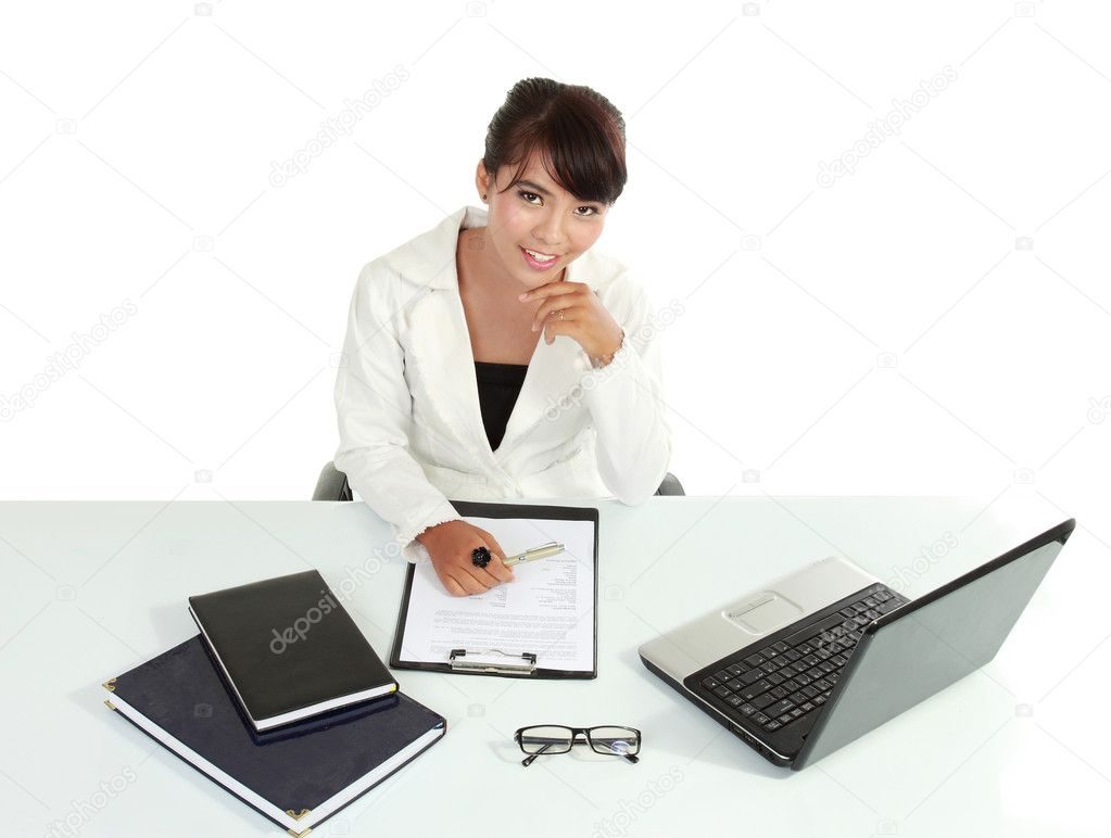 Smiling business woman with laptop. Isolated over white background.  Stock Photo #10638035