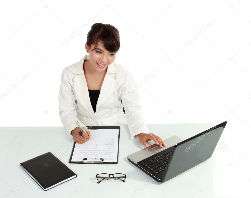 Beautiful asian woman working with her notebook. isolated over white background  Stock Photo #10638036
