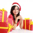 Girl in santa hat with bag full of xmas gift — Stock Photo #10670846