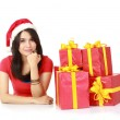 Girl with a gift and thinking — Stock Photo #10670847