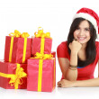 Girl in santa hat with pile of xmas gifts — Stock Photo #10670849