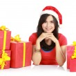Girl in santa hat with pile of xmas gifts — Stock Photo #10670850