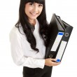 Portrait of a beautiful young business woman holding a folder, f — Stock Photo