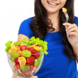 Pretty girl eating fruit salad — Stok fotoğraf