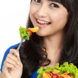 Portrait of smart young lady holding bowl of vegetable salad — Stock Photo #10670969
