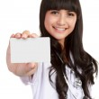 Young medical doctor woman showing business card — Stock Photo