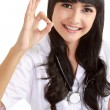 Asian doctor showing okay gesture - Stock Photo