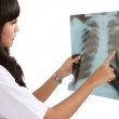 Female doctor looking at an x-ray. — Stock Photo