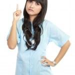 Female doctor pointing finger upwards — Stock Photo