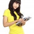 Asian woman reading book - Stock Photo