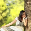 Beautiful girl in green nature - Stock Photo