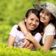 Girl friends smiling together — Stock Photo