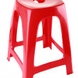 Red plastic chair - Stock Photo