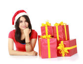 Girl with a gift and thinking — Stock Photo