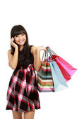 Shopping woman with bags talking on the phone — Stock Photo
