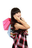 Young woman shopping and calling her friends — Stock Photo