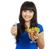 Beautiful woman holding huge glass of fruits — Stock Photo