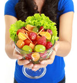 Closeup of a pretty young lady eating fruit salad — Stock Photo