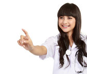 Young female surgeon pointing at copyspace — Stock Photo