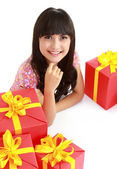 Woman with a lots of presents — Stock Photo