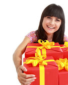 Woman with many gift boxes and bags — Stock Photo