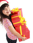 Christmas woman holding gifts wearing Santa hat — Stock Photo