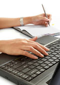 Woman write a book and typing her laptop — Stockfoto