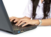 Female doctor working with laptop — Stock Photo