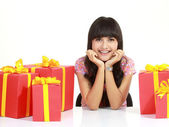Young woman surrounded by packages — Stock Photo