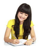 An asian woman writing a book — Stock Photo