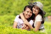 Girl friends smiling together — Foto de Stock