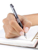 Writing in a notebook — Stock Photo