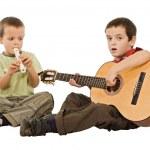 barn som leker med instrument — Stockfoto